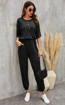 Button Down Loose Jumpsuit With Short Sleeve In Black by FS Collection