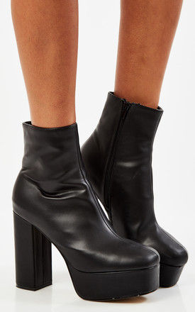 Black PU platform boots by Truffle Collection