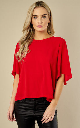 Oversized Short Sleeved Top in Red by Traffic People
