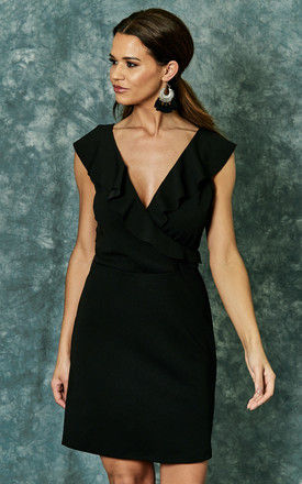 Black scuba crepe dress with ruffle detail by The Vanity Room