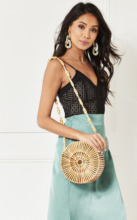 Wooden Round Handbag with beaded strap by India Gray