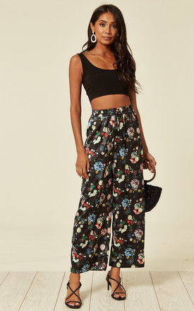 Satin floral print wide leg trousers in black by D.Anna