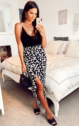 Satin daisy print midi wrap skirt in black with side tie by D.Anna