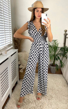 Retro Circle Jersey Jumpsuit in Black and White by KURT MULLER