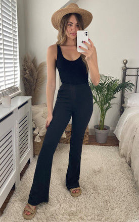 Flared High Waist Trousers in Black by Noisy May