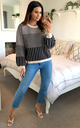 Stripe ribbed knit jumper with bell sleeves in black and beige by D.Anna