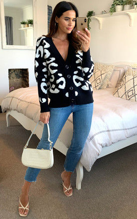 Black and white leopard button down ribbed knit v neck cardigan by D.Anna