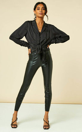 High waisted coated trousers in black by VILA