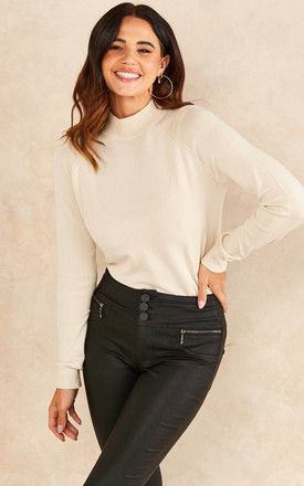 High neck knitted top in cream by Pieces