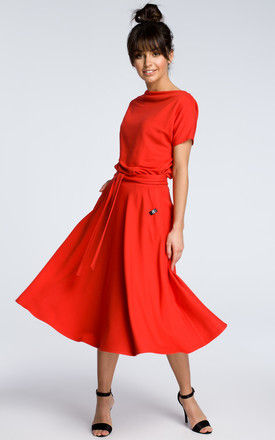 Red midi dress with loose-fitting top by MOE